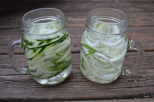 Spiralized Cucumber Water in Mason Jar Mugs